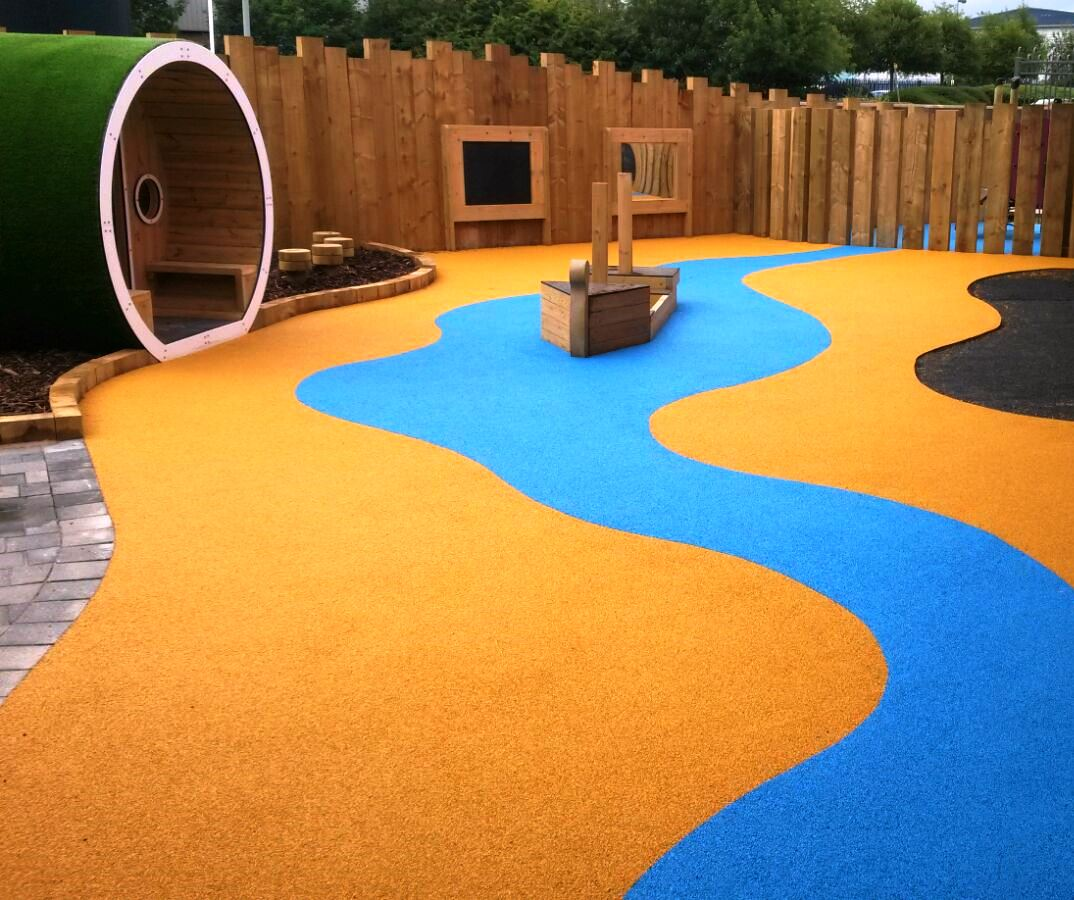 Playground wet pour rubber flooring in lancashire sports for Flooring surfaces