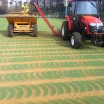 Installation of sand infill particles for artificial grass