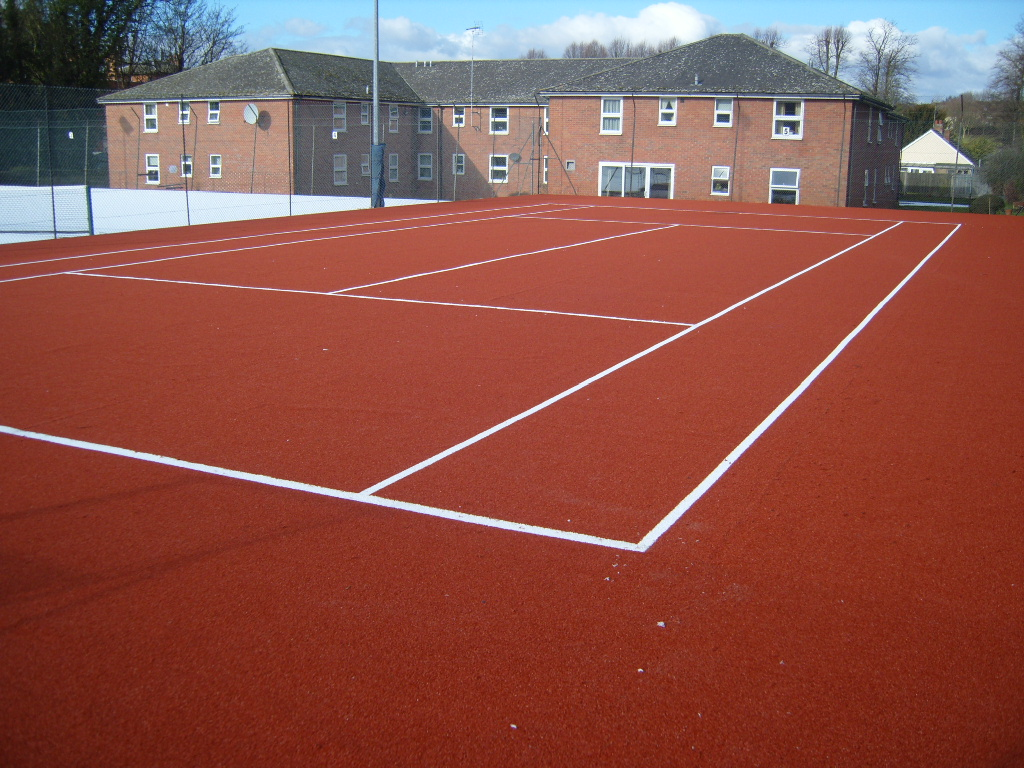How much to build an artificial clay tennis court for How much does it cost to build a sport court