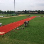 Installing Long Jump Turf Surfacing