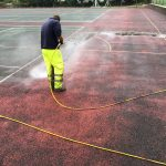 Cleaning Tennis Court